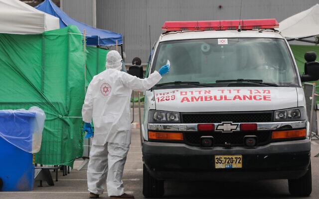 A Magen David Adom ambulance  service testing site in Bnei Brak on April 1, 2020. (Yossi Zamir/Flash90)