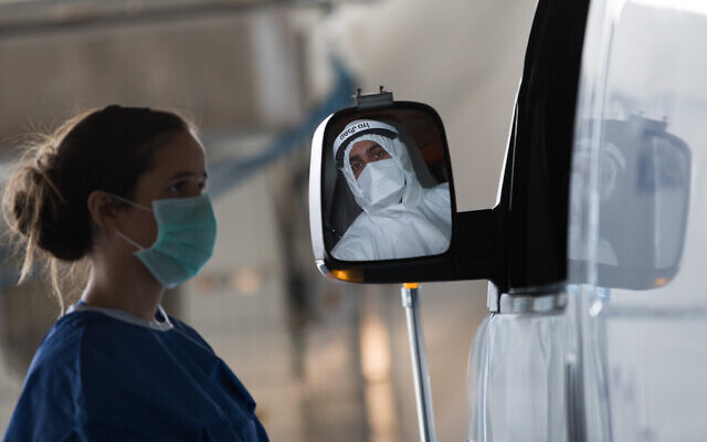 Magen David Adom workers wearing protective clothing, as a preventive measure against the coronavirus at Shaare Zedek hospital in Jerusalem on April 3, 2020. (Nati Shohat/Flash90)