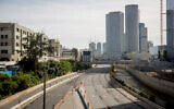 Illustrative: The empty Ayalon highway in Tel Aviv on April 4, 2020 (Miriam Alster/Flash90)