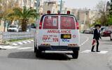 An ambulance driving in the central Israeli city of Elad, April 5, 2020. (Avshalom Sassoni/Flash90)