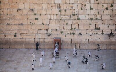 Jewish men during the priestly blessing at the Western Wall in Jerusalem's Old City on April 12, 2020. (Yonatan Sindel/Flash90)