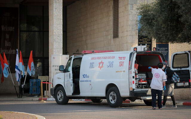 Illustrative: An ambulance outside the Dan hotel in Jerusalem, which was turned into a quarantine facility, on April 13, 2020. (Yossi Zamir/Flash90)