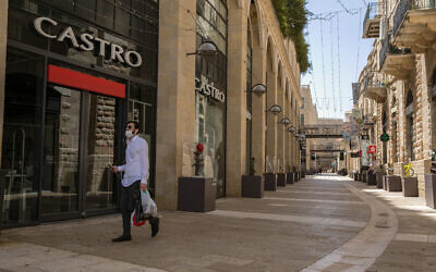 A man walks by closed shops in the Mamilla Mall near Jerusalem's Old City on April 22, 2020. (Olivier Fitoussi/Flash90)