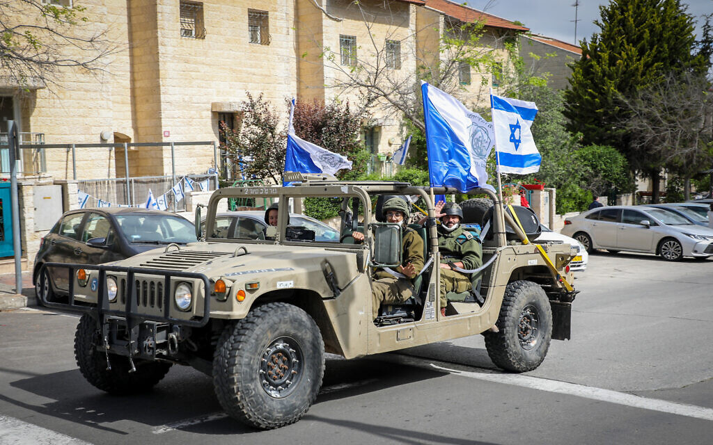 Military vehicles seen during a parade to mark Israel 's 72nd Independence Day in the West Bank settlement of Efrat, in Gush Etzion, April 29, 2020. (Gershon Elinson/Flash90)