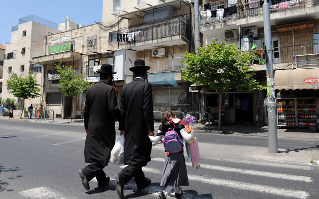 Illustrative: Ultra-OrthodoxJewish men walk in the Shmuel Hanavi  neighborhood in Jerusalem, June 6 2011. (Gili Yaari / Flash 90)