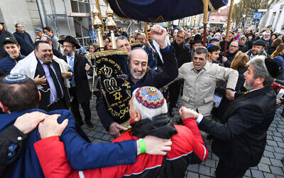 Jews dance with a Torah during the rededication of a synagogue in Konstanz, Germany in November 2019. (Felix Kästle/picture alliance via Getty Images via JTA)