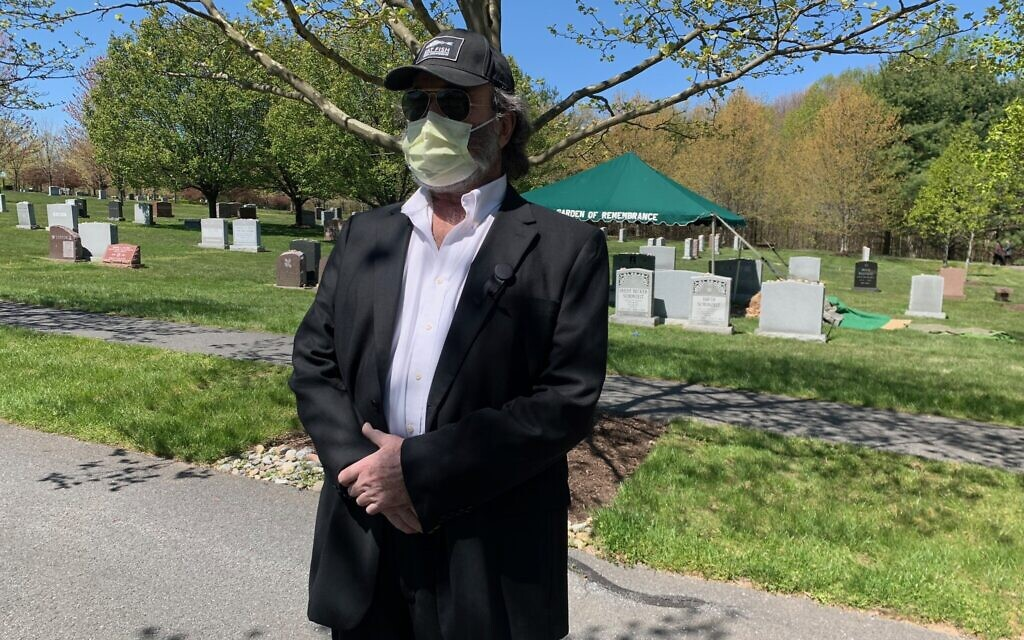 Andrew Grosz, 68, stands nearby his mother's burial at the Garden of Remembrance Cemetery on Wednesday, April 22, 2020. His mother, Anna Grosz, who survived the Holocaust, died of coronavirus (Courtesy).