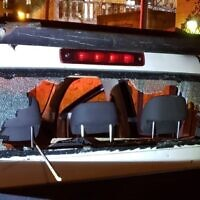 The damaged rear window of a Jerusalem municipality vehicle that had stones thrown at it, April 4, 2020 (Magen David Adom)