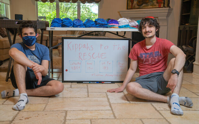 Matthew Jason (left) and Jeremy Jason at headquarters for their Kippas to the Rescue project, at home in Houston, April 2020. (Mark Jason)