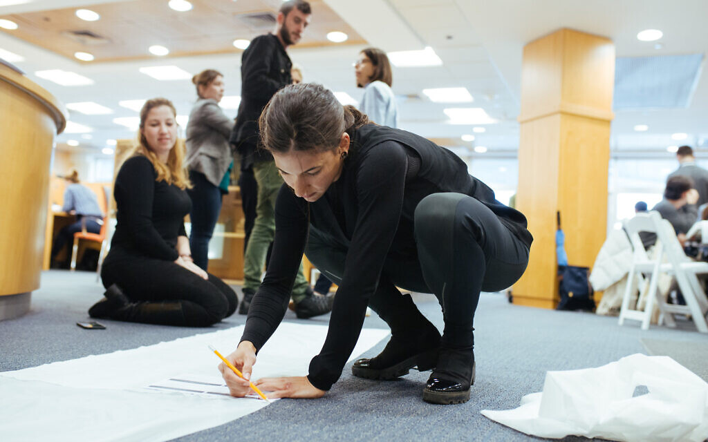 The Skinly team draws a garment prototype, January 8-9, 2020. (Courtesy)