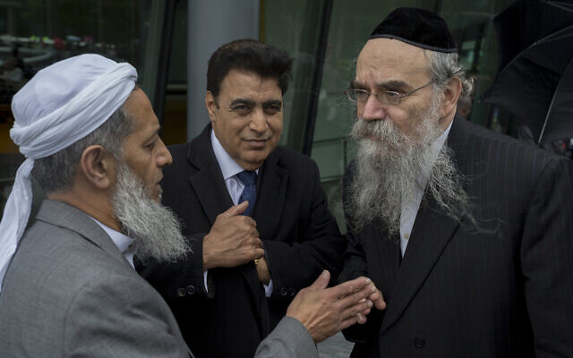 Rabbi Avrohom Pinter, right, speaks with other community leaders in London, June 5, 2017. (Richard Baker / In Pictures via Getty Images via JTA)