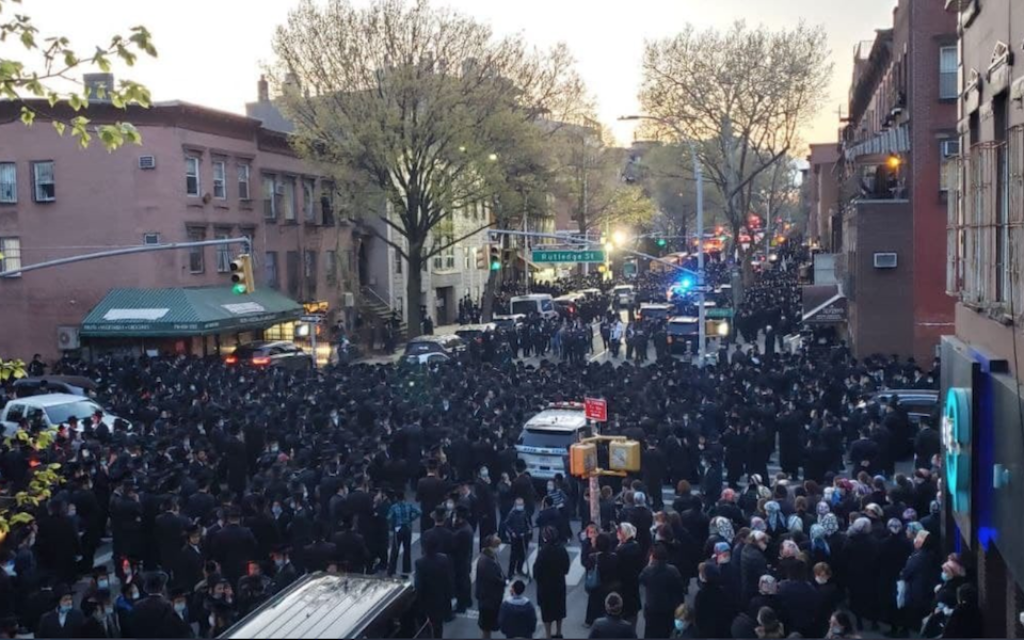 Haredi Orthodox Jews gather in Brooklyn for the funeral of Rabbi Chaim Mertz, April 28, 2020. (Reuven Blau/Twitter, via JTA)