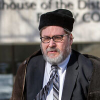 Rabbi Bernard Freundel leaves the DC Superior Court House in Washington, February 19, 2015. (AP/Cliff Owen, File)
