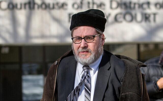 Rabbi Bernard Freundel leaves the DC Superior Court House in Washington, February 19, 2015. (AP/Cliff Owen, File)