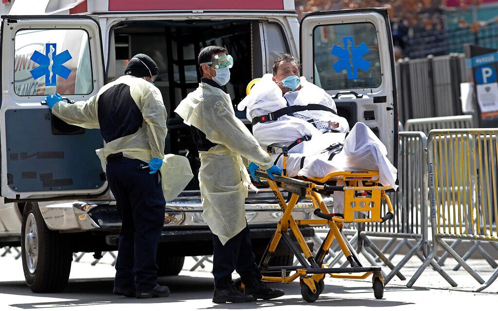 Trump threatens to defund WHO as US coronavirus deaths surge past 12,800