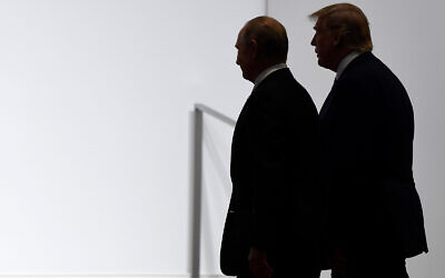 US President Donald Trump and Russian President Vladimir Putin walk to participate in a group photo at the G20 summit in Osaka, Japan, June 28, 2019. (AP/Susan Walsh, File)