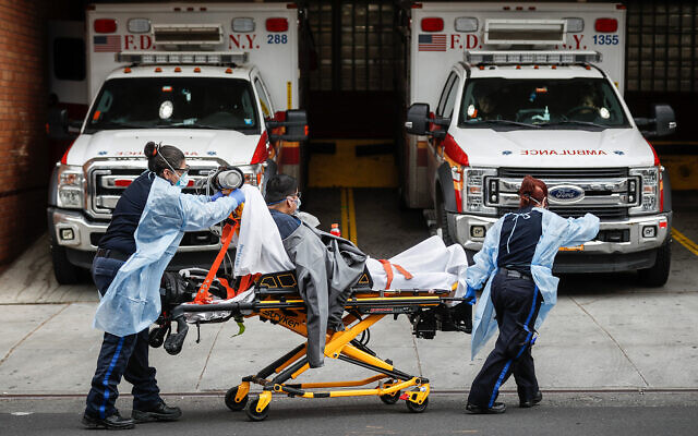 Patients are brought into Wyckoff Heights Medical Center in Brooklyn, New York, April 7, 2020. (AP/John Minchillo, File)
