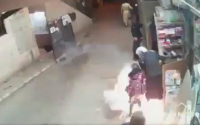 A stun grenade thrown by police hits a 9-year-old girl during riots in the ultra-Orthodox neighborhood of Mea Shearim on April 16, 2020. (Screenshot: Twitter)