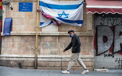 A man walks on Jaffa street in downtown Jerusalem, March 28, 2020. (Nati Shohat/Flash90)