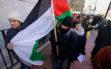 Illustrative: Northeastern University students protest after Students for Justice in Palestine was temporarily suspended by the university, March 18, 2014. (AP/Stephan Savoia)