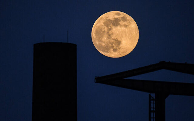 The supermoon seen at a closed factory in Dortmund, western Germany, April 7, 2020. (Ina Fassbender/AFP)
