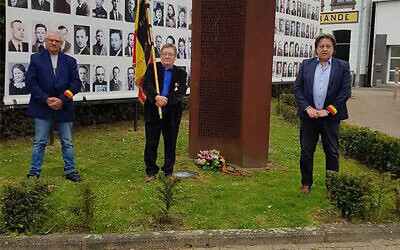Michel Baert, right, and two commemoration activists laying a wreath at a Holocaust monument in Boortmeerbeek, Belgium on April 19, 2020. (Michel Baert via JTA)