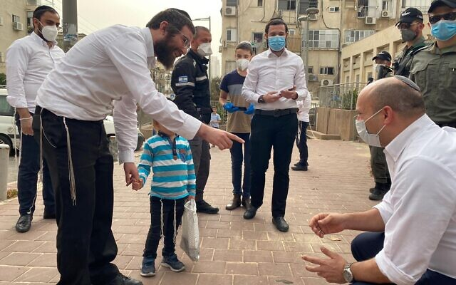 Defense Minister Naftali Bennett (R) visits the virus-hit city of Bnei Brak on April 5, 2020. (Courtesy)