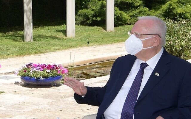 President Reuven Rivlin meeting with small business owners hit by the coronavirus crisis, at his residence in Jerusalem, April 19, 2020. (Avi Kanner/GPO)