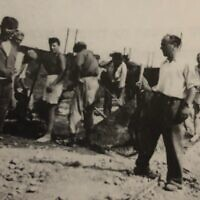 Dr. Hanan Karshai (left, wearing briefs and a hat) as an 18-year-old forced laborer, captured in a rare snapshot that was discarded by the posing Hungarian soldier (far left). (Courtesy)