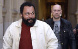 Dieudonne M'bala M'bala, left, and Alain Soral arrive at the Paris courthouse for Soral's trial for inciting hatred against Jews, March 12, 2015. (Loic Venance/AFP via Getty Images/ JTA)