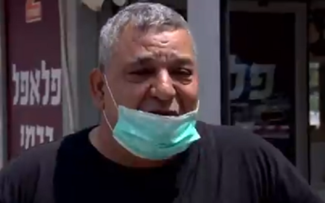 Yuval Carmi, a falafel store owner in Ashdod who has been hit hard by the pandemic, April 19, 2020. (screen capture: Channel 13)