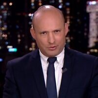 Defense Minister Naftali Bennett is interviewed on Channel 12 news, April 4, 2020 (Screen grab)