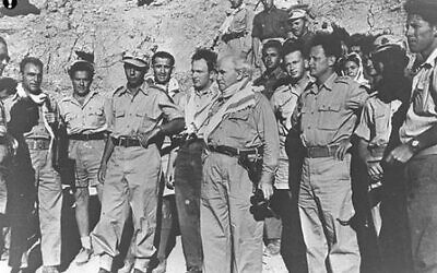 Prime Minister David Ben-Gurion, Southern Front Commander Yigal Allon (to his right) and Yitzhak Rabin (between them) pictured on the southern front during the 1948 War of Independence. (IDF / Wikipedia)
