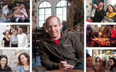 Tmol Shilshom David Ehrlich, center, who died suddenly on March 23, 2020, with photos of friends and customers from his cafe (Tmol Shilshom crowdfunding project)