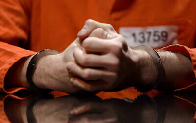 Illustrative: A prisoner in handcuffs (Motortion; iStock by Getty Images)