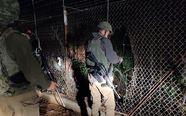 Soldiers inspect damage at the border fence between Israel and Lebanon, April 17, 2020 (Israel Defense Forces)