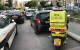 Police and Magen David Adom vehicles at the scene of a suspected murder in Holon, April 28, 2020. (Magen David Adom)
