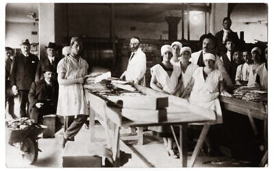 Representatives of the Pest Jewish Community visit the community's matzo bakery on Tuzer Street in the 1920s. (Photograph by Kalman Boronkay/ Courtesy CEU Press)