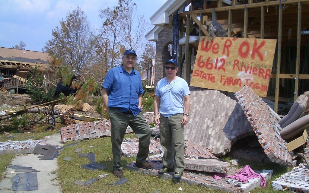 Irwin Redlener with Paul Simon in New Orleans after Hurricane Katrina, 2005. (Courtesy)