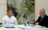 Prime Minister Benjamin Netanyahu and his son Avner hold a Passover Seder, April 8, 2020. (video screenshot)