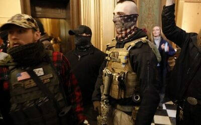 Protestors try to enter the Michigan House of Representative chamber and are being kept out by the Michigan State Police after the American Patriot Rally organized by Michigan United for Liberty protest for the reopening of businesses on the steps of the Michigan State Capitol in Lansing, Michigan on April 30, 2020. (JEFF KOWALSKY/AFP)