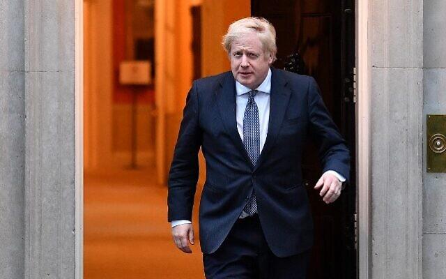 Britain's Prime Minister Boris Johnson walks of 10 Downing Street in central London on April 30, 2020. (Ben STANSALL / AFP)