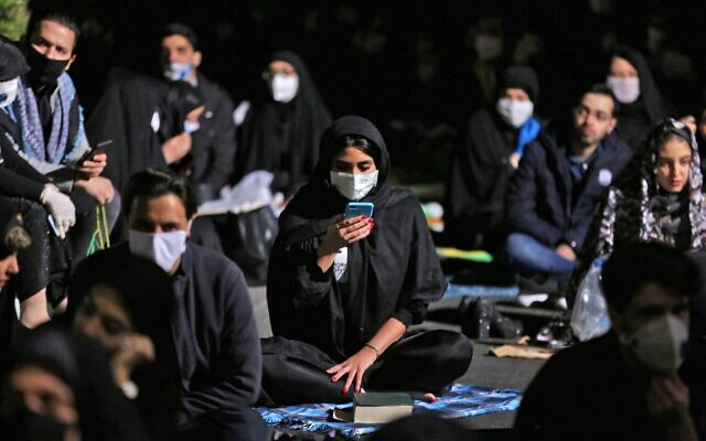 Iranians attend prayers for Laylat al-Qadr, one of the holiest nights during the Muslim fasting month of Ramadan, outside a mosque in the Tehran, on May 13, 2020. (Atta Kenare/AFP)