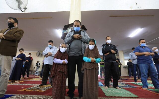 Palestinians perform an Eid al-Fitr prayer despite concerns over the COVID-19 coronavirus outbreak at a mosque in Gaza City early on May 24, 2020, after the local authorities allowed mosques to reopen amid the easing of some social distancing restrictions. (MAHMUD HAMS / AFP)
