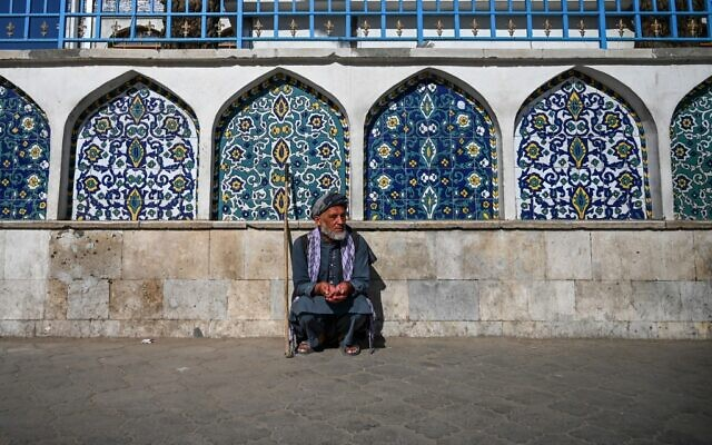 A man sits outside the Pul-e Khishti mosque at the start of the Eid al-Fitr festival which marks the end of the Muslim holy month of Ramadan in Kabul on May 24, 2020 (WAKIL KOHSAR / AFP)