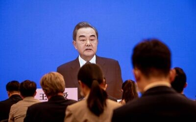 China's Foreign Minister Wang Yi speaks during his online video link press conference during the National People's Congress (NPC) at the media center in Beijing on May 24, 2020. (NICOLAS ASFOURI / AFP)