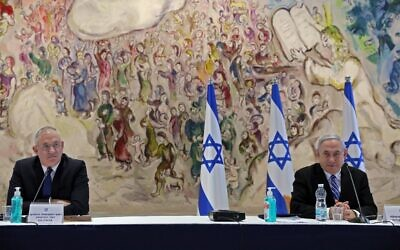 Prime Minister Benjamin Netanyahu (R) and Defense Minister Benny Gantz (L) attend a cabinet meeting of the new government at Chagall State Hall in the Knesset in Jerusalem on May 24, 2020. (Abir Sultan/Pool/AFP)