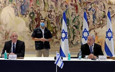 Prime Minister Benjamin Netanyahu (R) and Alternate Prime Minister and Defense Minister Benny Gantz (L) attend a cabinet meeting of the new government at Chagall State Hall in the Knesset in Jerusalem on May 24, 2020. (Abir Sultan/Pool/AFP)