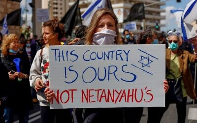 Protesters rally against Prime Minister Benjamin Netanyahu outside his residence in Jerusalem on May 24, 2020. (Emmanuel Dunand/AFP)