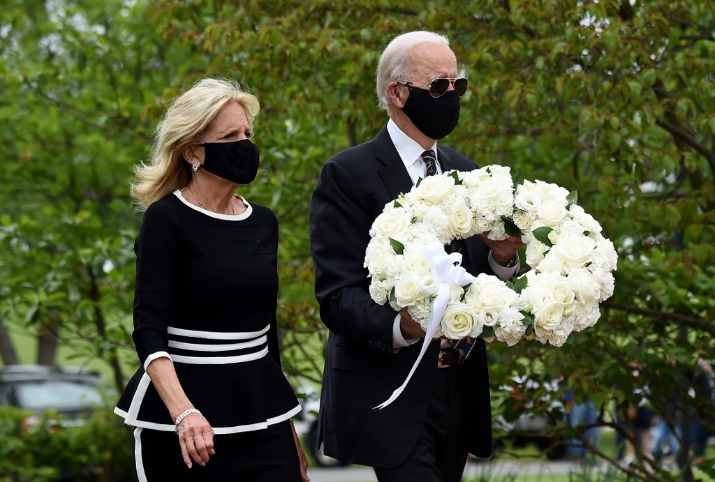 Democratic presidential candidate and former US vice president Joe Biden with his wife Jill Biden pay their respects to fallen service members on Memorial Day at Delaware Memorial Bridge Veteran's Memorial Park in Wilmington, Delaware, May 25, 2020. (Olivier Douliery/AFP)